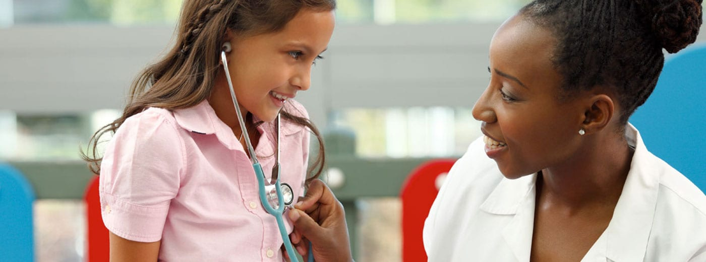Photo of a little girl and doctor with a stethoscope