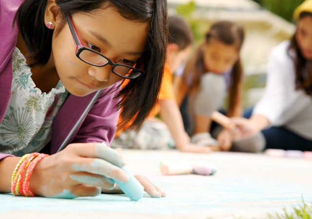 Photo of girl with glasses fingerpainting