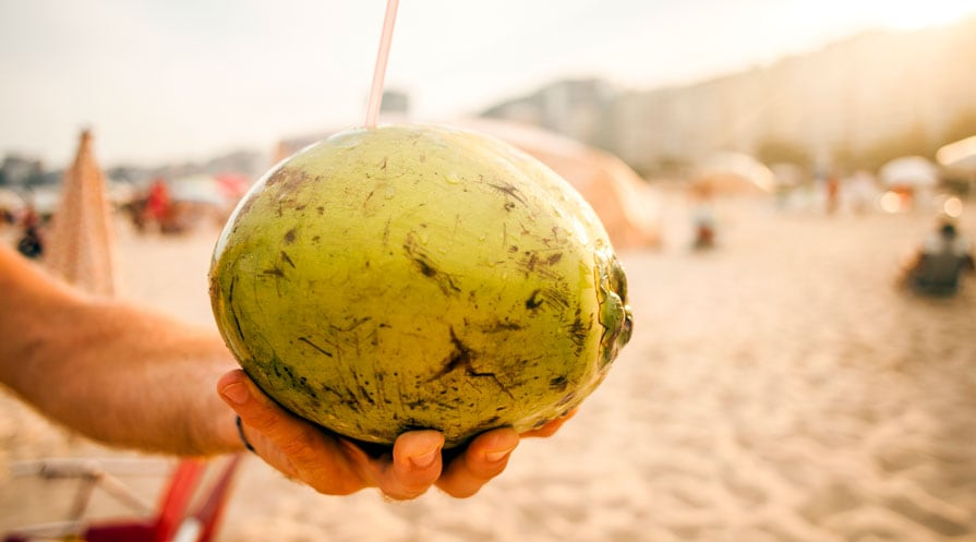 hands holding coconut