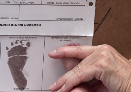 infant's left footprint on document