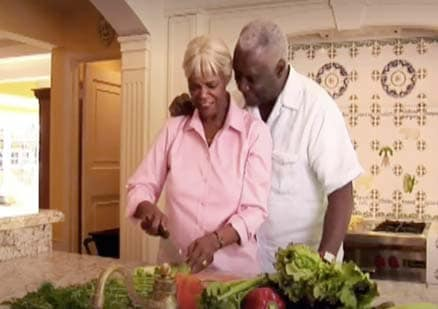 happy couple prepares food together at home