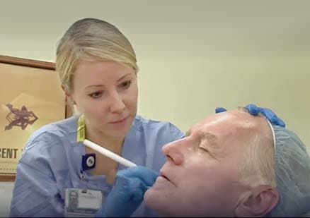 nurse examines patients skin