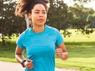 Woman jogging outside in nature