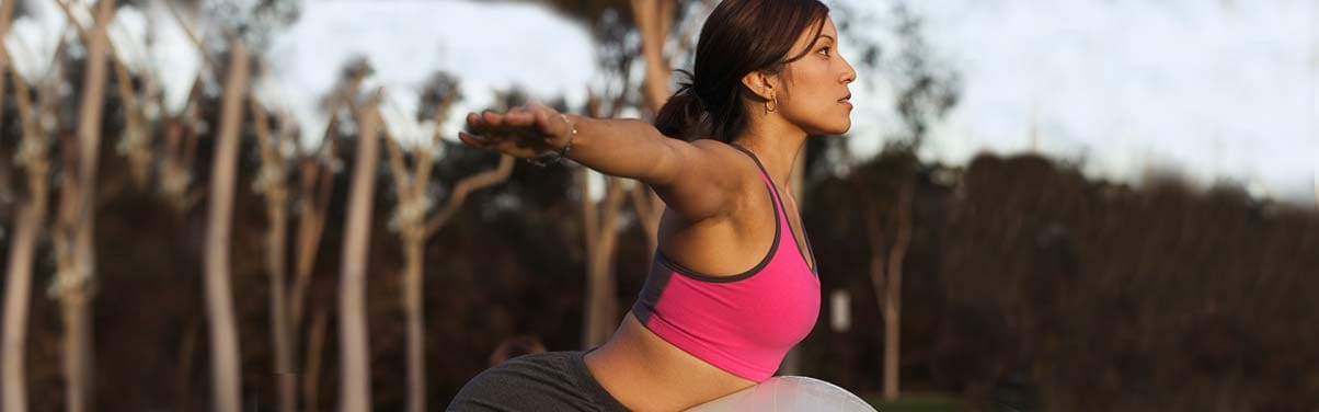 Young athletic woman stretching outside